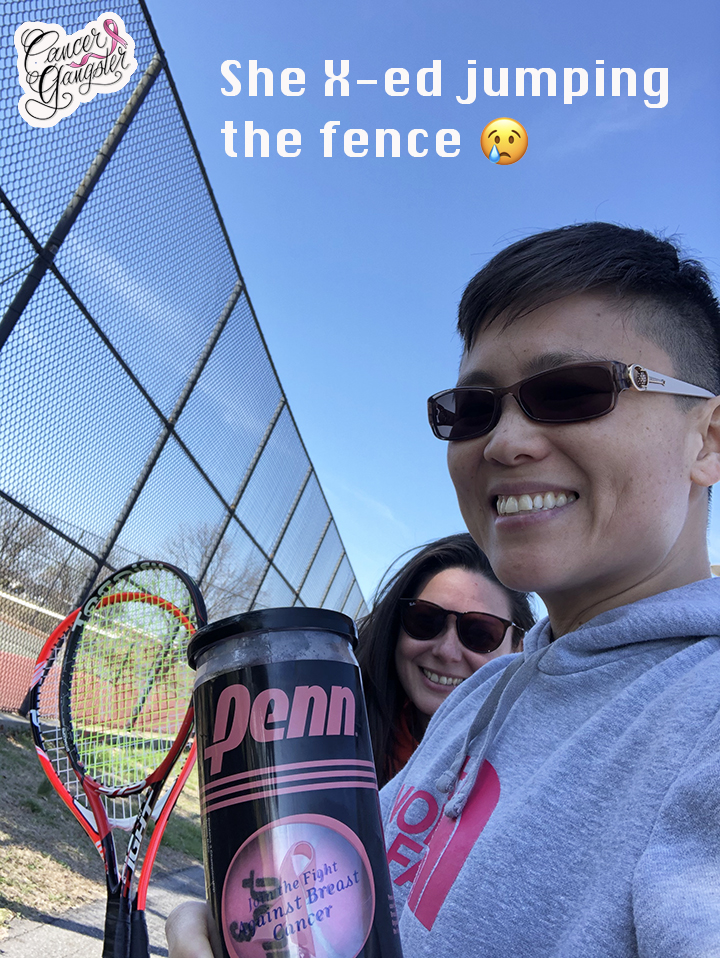 Two girls outside tennis courts with rackets and balls.